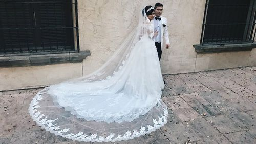 Gladys Salinas's father reacted emotionally after seeing her in her wedding dress.