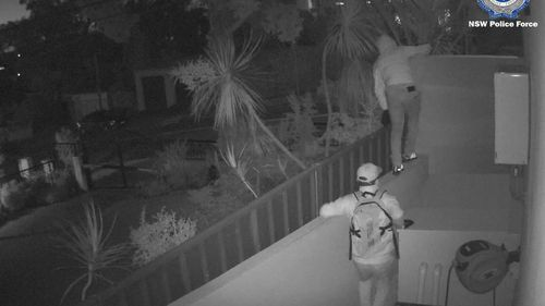 CCTV footage shows two members breaking and entering a property in Sydney.