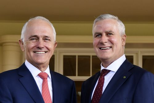 Newly elected Nationals party leader Michael McCormack is congratulated by Prime Minister Malcolm Turnbull after being sworn in as Australia's Deputy Prime Minister during a ceremony in Canberra. Picture: AAP