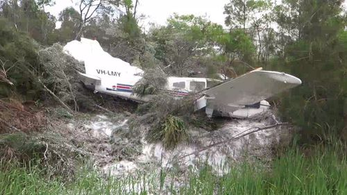 "Paramedics said it was a ""miracle"" the pilot walked away without injury. (9NEWS)"