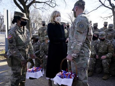 First lady Jill Biden surprises National Guard members  chocolate chip cookies. (AP Photo/Jacquelyn Martin, Pool)