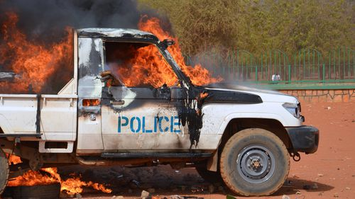 A police truck set on fire by protesters in a demonstration against Charlie Hebdo in Niamey. (Getty)