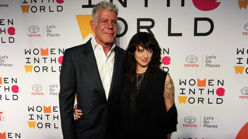 Bourdain with partner, actress Asia Argento, in New York in April. (Getty)