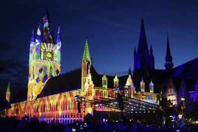 Cloth Hall in Ypres, Belgium lit up during an event.