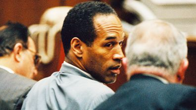 O.J. Simpson confers with his lawyer F. Lee Bailey during a pre-trial hearing January 12, 1995.