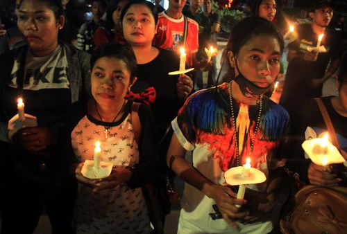 Indonesians have held candle light vigils for the people killed in the IS-inspired bombings. (AAP)