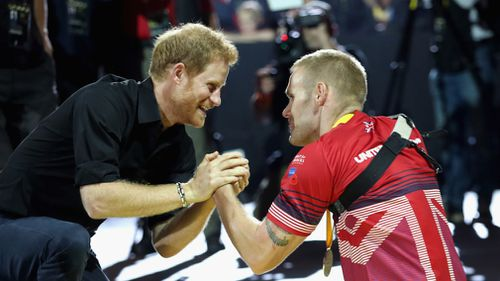 Prince Harry shakes the hand of Mark Omrod after he won second place at the Minute Indoor Rowing in the IR1 category at the Invictus Games at the Mattamy Athletic Centre in Toronto