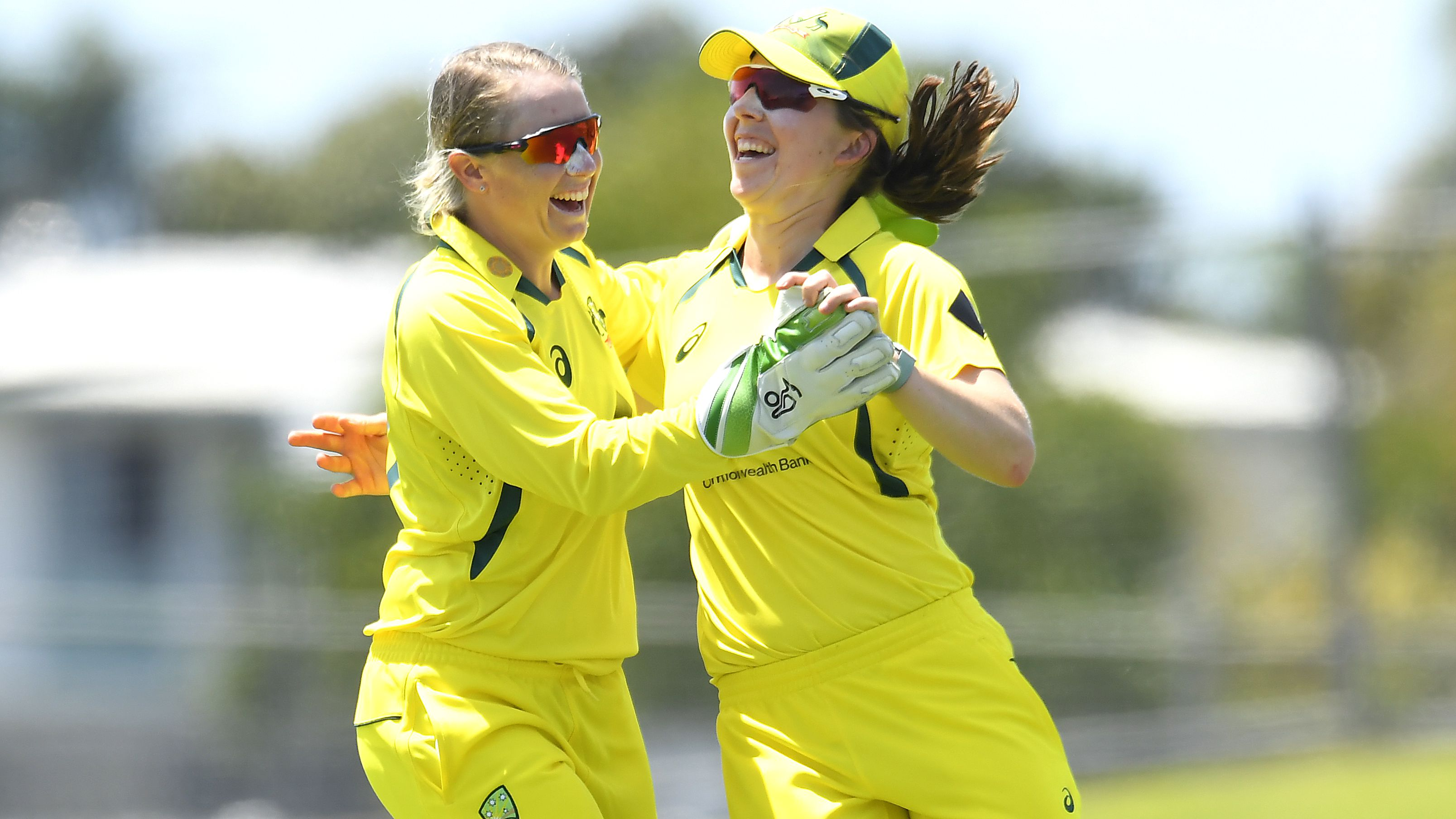 Georgia Wareham of Australia celebrates with Alyssa Healy after catching out Deepti Sharma of India.