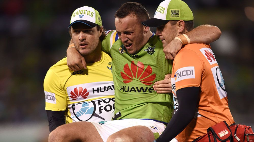 Trainers carry off Josh Hodgson (AAP)