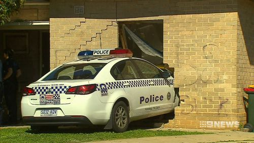 A police car has ploughed through the front room of a home in Adelaide's northern suburbs after responding to a disturbance incident.