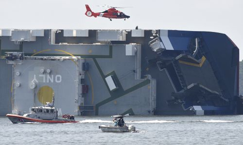 The Coast Guard rescued four crew members trapped on the ship.