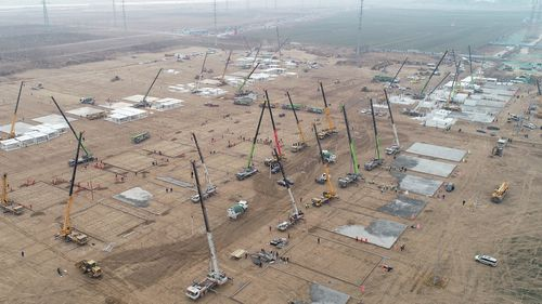 In this aerial photo released by China's Xinhua News Agency, workers build a large centralised quarantine facility in Shijiazhuang in northern China's Hebei Province, Thursday, Jan. 14, 2021