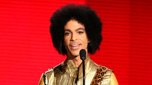Prince presents the award for favourite album - soul/R&B at the American Music Awards in Los Angeles in 2015. (AP)