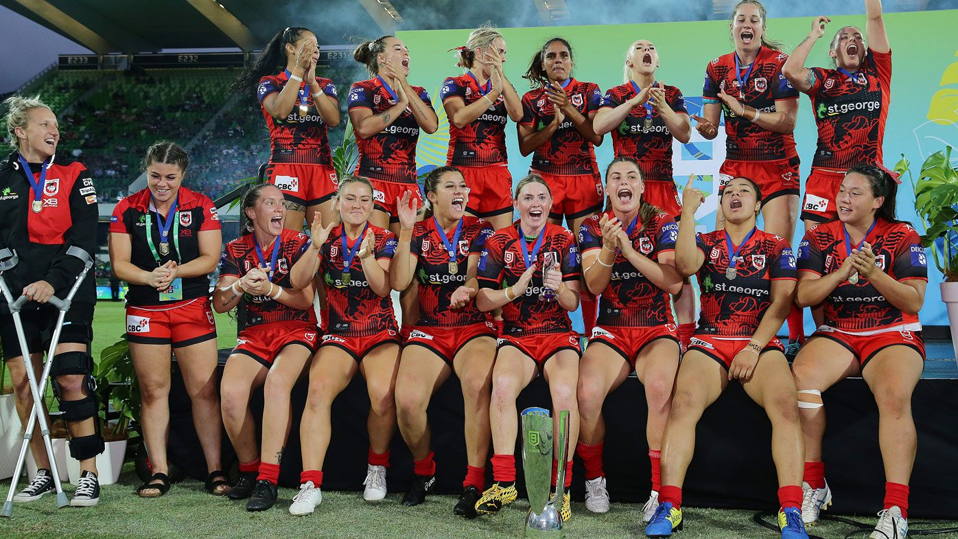 The Dragons celebrate after winning the final