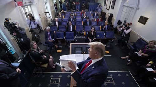 Donald Trump shows some documents to the White House press corps.