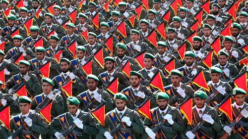 Iran's Revolutionary Guard troops march in a military parade in Tehran.