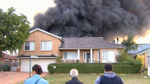 Moorebank factory fire comes dangerously close to homes