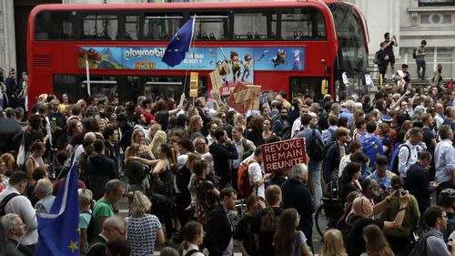 Anti-Brexit supporters gather outside 10 Downing Street after Johnson's move to suspend parliament.