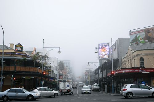 Fog obscures the view down Hindley Street in the Adelaide CBD this morning. Picture: AAP