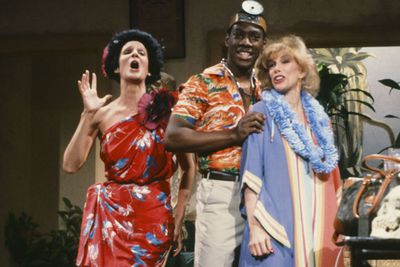 """In 1983, Joan tried her hand at sketch comedy on an episode of NBC's <i>Saturday Night Live</i>.<br/><br/>Cue the hilarious """"Carribbean Gyno"""" skit here alongside former <I>SNL</I> cast members Mary Gross and Eddie Murphy. <br/><br/>Source: Getty"""