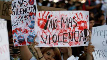 A woman holds a sign that reads 'No More Silence' during protests in the Mexican city of Guadalajara.
