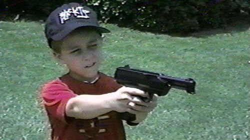 Andrew Golden is shown holding a pistol in this undated image from a home video. Golden and Mitchell Johnson, 13, lured classmates out of Westside Middle School in Jonesboro, Arkansas, with a false fire alarm, and then began shooting. Four girls and an English teacher who shielded a student were killed in the 1998 attack.