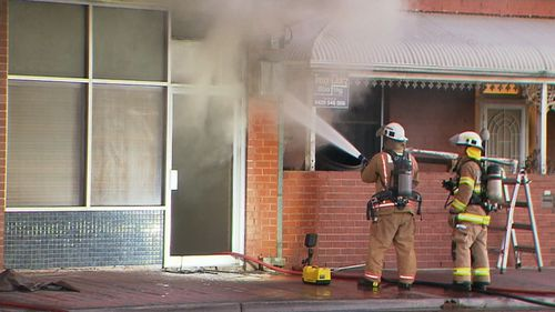 The Grand Junction Road business caught fire just before 5.30am.