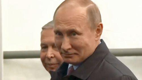 Vladimir Putin has won the election by a landlside, polls suggest.