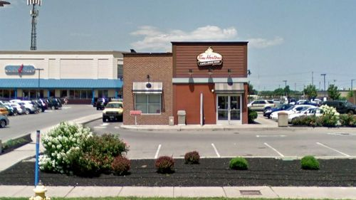 The boy fell into the grease trap embedded in the ground outside a Tim Hortons restaurant.
