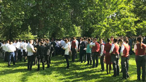 Hotel staff were evacuated to nearby Hyde Park. (AAP)
