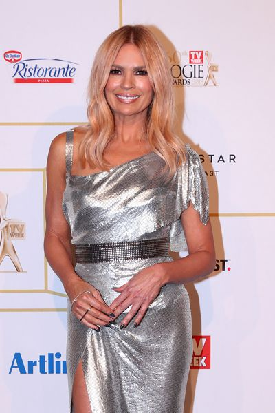 Sonia Kruger paired her bedazzling silver gown with voluminous, curly lashes