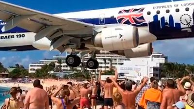 """<p _tmplitem=""""8"""">It might look fake, but sometimes truth is stranger than fiction.</p> <p _tmplitem=""""8""""> A man has filmed a plane landing at an airport on the Caribbean island of Saint Martin – which happens to sit so close to a public beach you almost have to duck for cover. </p> <p _tmplitem=""""8""""> Runway 10 at Princess Juliana International Airport backs onto Maho Beach, on the Dutch side of Saint Martin, 300km east of Puerto Rico. </p> <p _tmplitem=""""8""""> The slow-motion footage of the plane landing was uploaded to Instagram by San Francisco man Paul Luning last month. </p> <p _tmplitem=""""8""""> """"Flying frequently tends to make one either bitter or obsessed with aviation. I fall into the latter category,"""" Mr Luning said. </p> <p _tmplitem=""""8""""> """"Visiting Maho Beach in Saint Marteen was always on my bucket list. It's as crazy as it looks — planes landing just feet from a public beach."""" </p> <p _tmplitem=""""8""""> The proximity and novelty of a 2300 metre runway sitting next to an otherwise idyllic beach has seen the area become a tourist attraction. </p> <p _tmplitem=""""8""""> Visitors regularly pose for pictures underneath the landing planes or hold onto the fence and are blasted by the jet exhaust during take-off. </p> <p _tmplitem=""""8""""> </p>"""