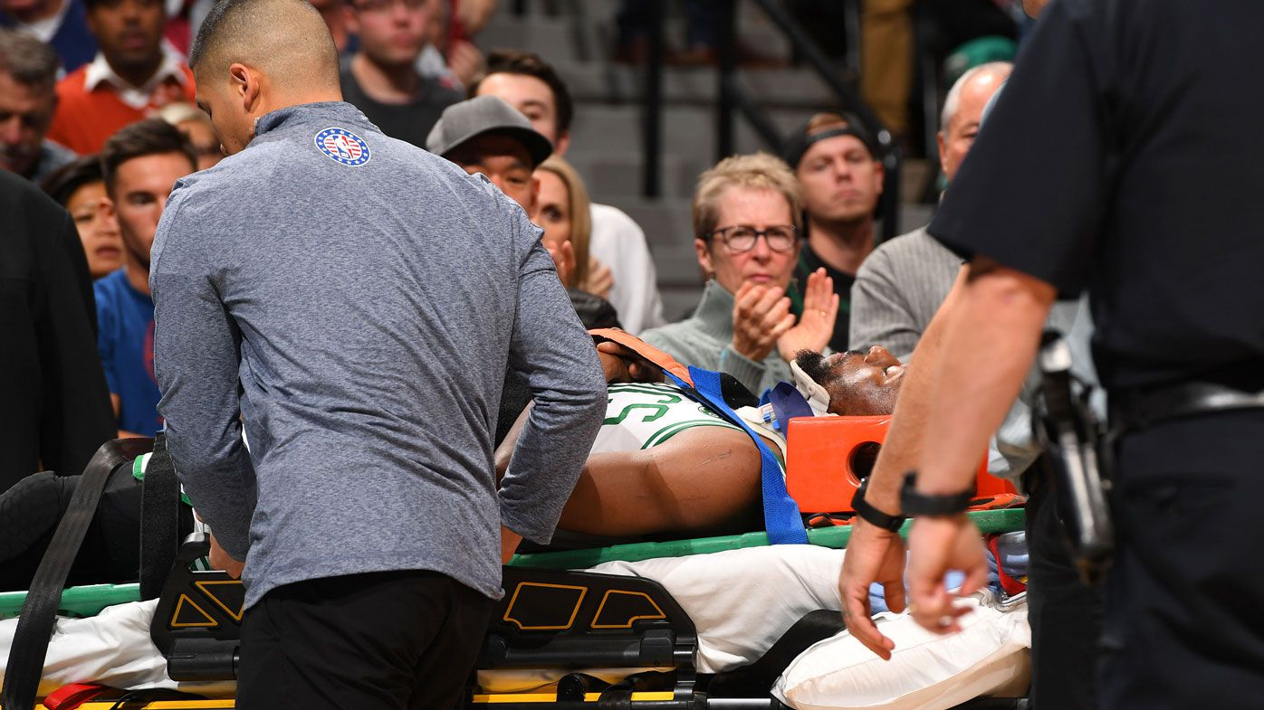 Celtics star Walker stretchered off after scary collision, Simmons fires for 76ers
