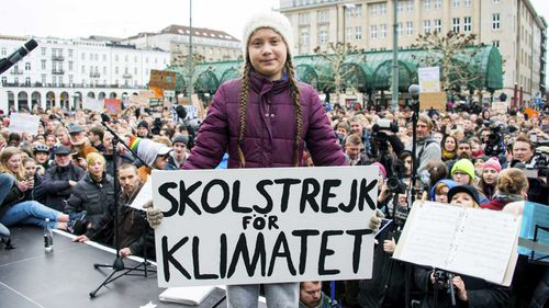 Greta Thunberg holds a sign reading 'School Strike For The Climate' at a rally in Hamburg, Germany.