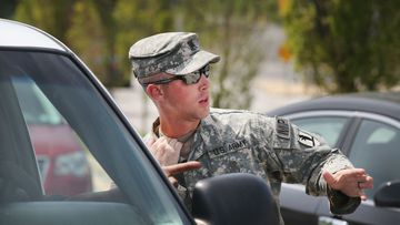 A Military Police officer with the Missouri Army National Guard directs traffic in Ferguson. (AP)
