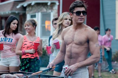 Like a fine wine, Zac Efron seriously improves with age. Look at those pecs!<br/><br/>(Image: Universal Pictures)
