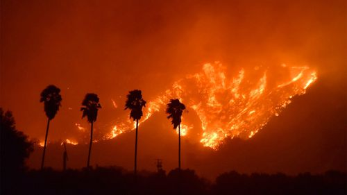 At least 150 structures have burned so far. (AAP)