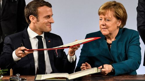 French President Emmanuel Macron and German Chancellor Angela Merkel sign the renewed friendship treaty in Aachen.
