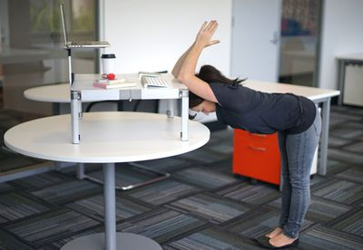 Standing elbow-to-desk stretch