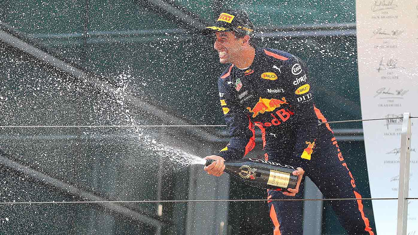 Australian F1 driver Daniel Ricciardo of Red Bull Racing sprays champagne