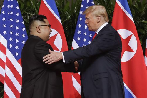 Donald Trump and Kim Jong-un broke the ice with a long handshake in their first official meeting. Picture: AAP