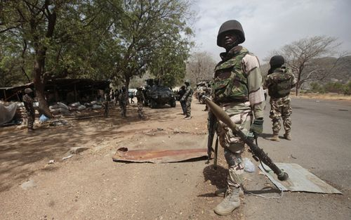 Nigerian soldiers man a checkpoint in Gwoza, Nigeria, looking for Boko Haram terrorists. (AAP).