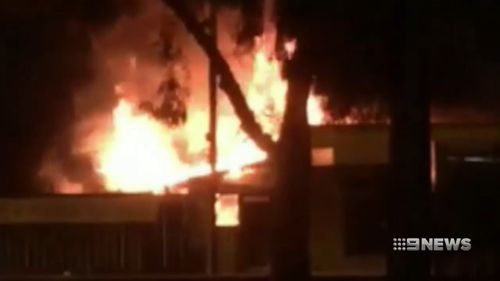 Police say a fire which gutted a home and shopfront was deliberately lit.