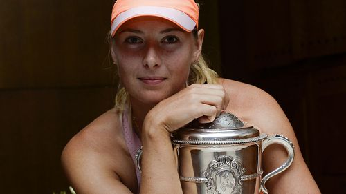 Maria Sharapova with her final Grand Slam trophy, the 2014 French Open.