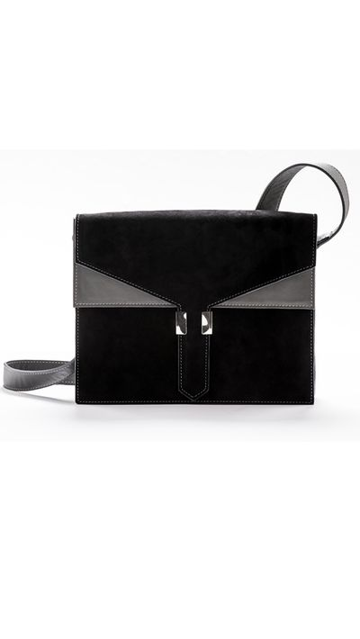 """<a href=""""http://www.amandakendell.com/collections/frontpage/products/cuzco-day-bag-black-grey"""" target=""""_blank"""">Cuzco Messenger Bag, $710, Amanda Kendall</a>"""