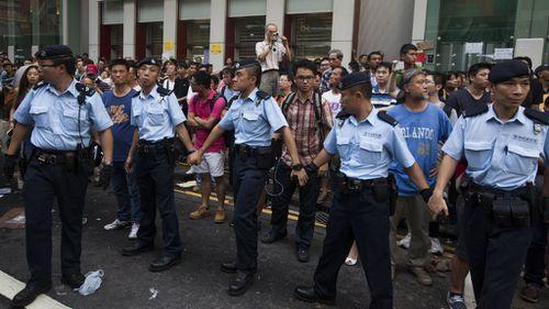 Police hold back demonstrators. (AAP)