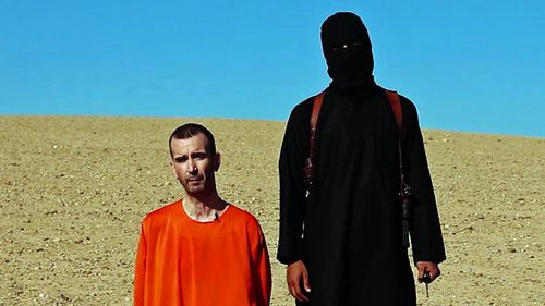 Part of a video released by the Islamic State in 2014 shows Mohammed Emwazi, dubbed Jihadi John, holding a knife before purportedly executing British journalist David Cawthorne Haines. (Photo: AP).