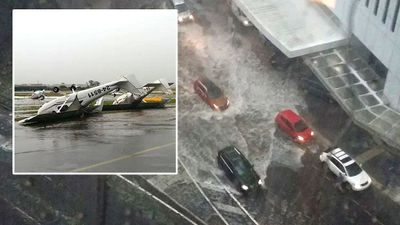 Flash flooding sees cars affected in Brisbane as planes were flipped at a local airport. (Supplied)