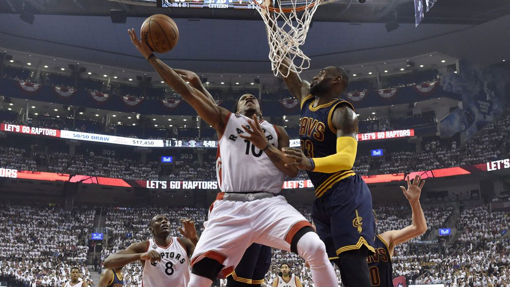 DeMar DeRozan hits the basket under the attention of LeBron James. (AAP)