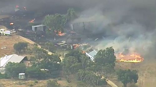 Local residents assisted in attempts to quell the blaze. (9NEWS)